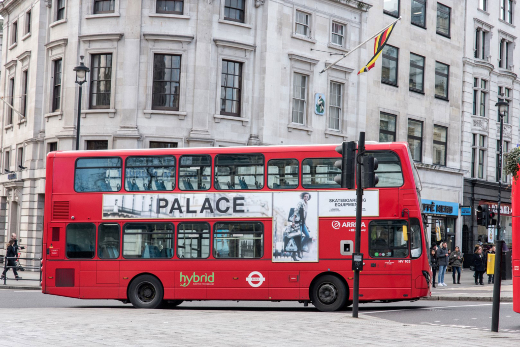 palace red bus ad london